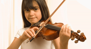 Young child playing violin fiddle